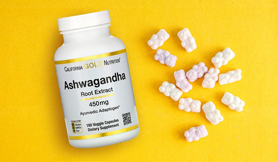 Ashwagandha supplement bottle and gummies on yellow background