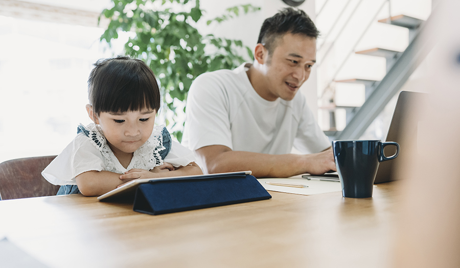 Father and daughter working together at home