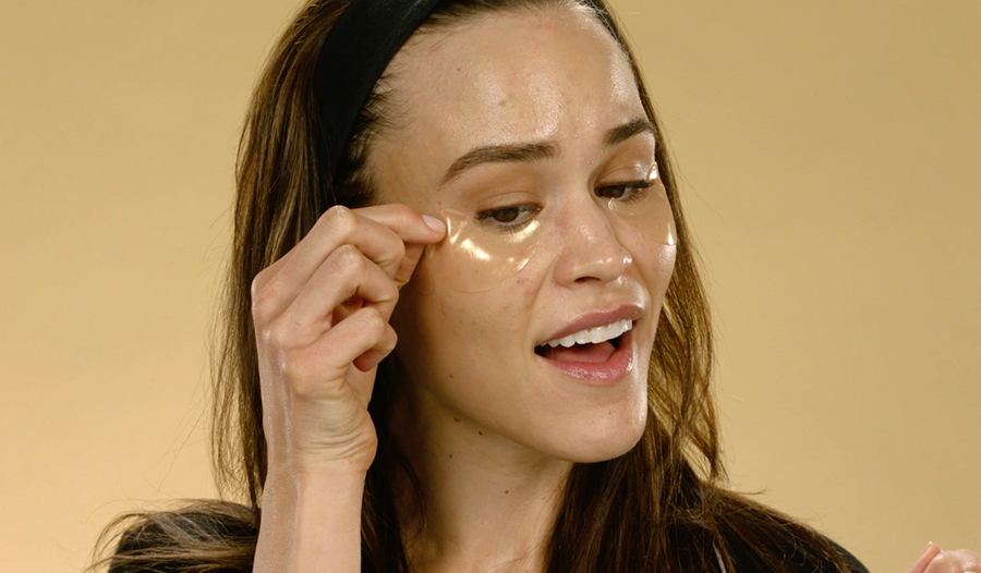 woman applying gel eye patches to her undereyes
