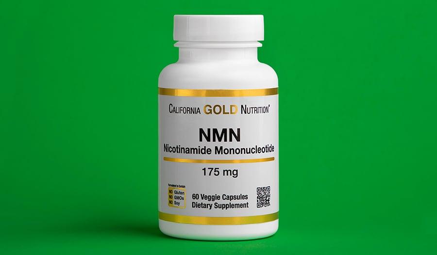 Nicotinamide adenine dinucleotide (NAD+) supplement bottle on green background