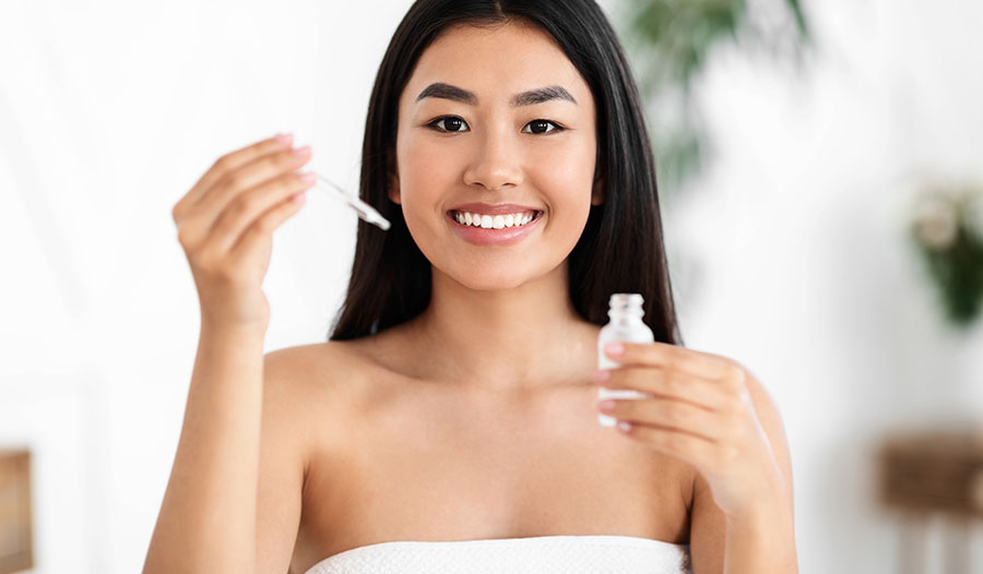 woman trying a new skincare serum in a starter kit size
