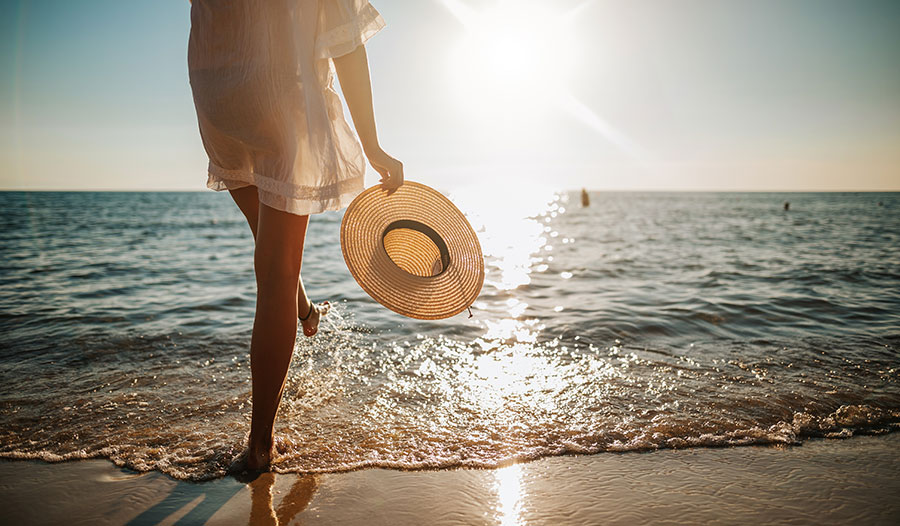 woman at the beach standing near the water