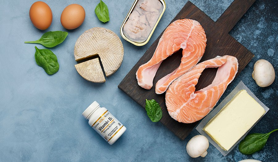 Vitamin D foods like eggs, spinach, salmon, sardines, and supplement bottle