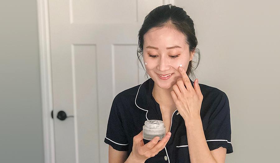 dr jenny liu applying retinol skincare to her face