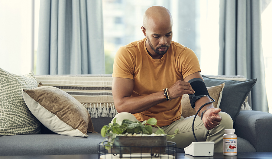 Male checking blood pressure at home