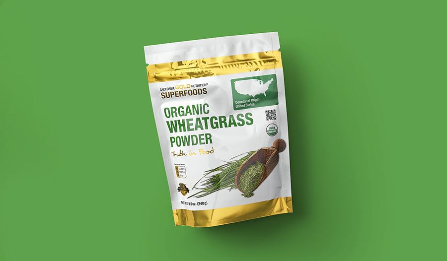 Wheatgrass powder on green background